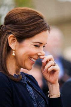 Crown Princess Mary of Denmark smiles during her visit of the international horse show CHIO in Aachen, Germany, 25 June 2013