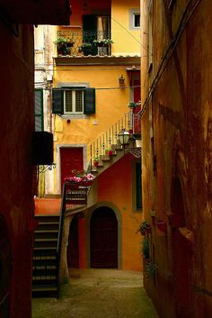 Back alley street to the orange house in Orvieto, Italy.