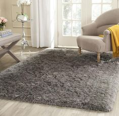 Safavieh's Arctic Collection brings sensational plush textures in solid colors to ultra-soft shags. This densely woven, hand-tufted ivory rug is made using extra-long, plush synthetic yarns for a natural, rustic-chic look. This luxurious shag is comf Grey Shag Rug, Grey Rugs, Shag Rugs, Shag Carpet, Grey Carpet, Frieze Carpet, Polyester Rugs, Transitional Bedroom, Best Carpet