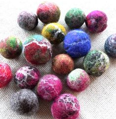 100% all natural wool. These are handmade with 100% wool and then felted. The felting process continues with use. They are roughly the size of a golf ball. This listing is for one toys