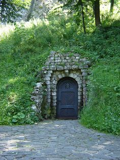 blue door into the hill