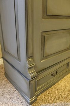 """After - Armoire.  Annie Sloan Chalk paint; Graphite and French Linen, 50/50 mix.  Graphite trim details.  Graphite """"wash"""" over details,carvings then dry ragged off.  Then heavily dark waxed.  Handles done in rubbed oil bronze.  #ASCP #morethanpaint Check my other projects!"""