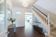 Wide entrance hall, stairs and landings in modernised Victorian house ...