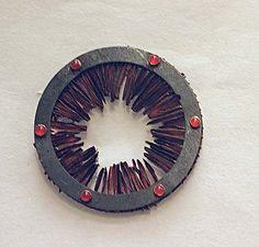 Ralph Bakker - brooch: iron, copper & agat
