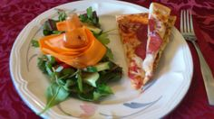 fast food made healthy...leftover pizza with a gathered salad of spinach, purslane, parsley, shaved carrots and home made dressing