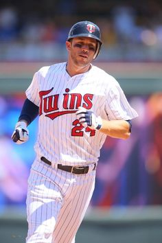 Trevor Plouffe #24 of the Minnesota Twins rounds second base after hitting a two run homer against the Chicago Cubs during interleague play at Target Field on June 9