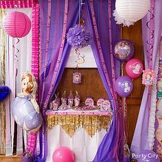 Transform a regular table with a DIY Sofia the First canopy into a royal spot keep presents, favors, or desserts! Click for this & more fun party ideas!