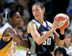 Rebecca Lobo of the New York Liberty is defended by Lisa Leslie of the Los Angeles Sparks during a game in 1997, the early days of the WNBA.