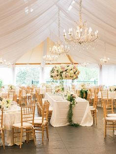 Deck out outdoor wedding decor with dreamy details, like whimsical chandeliers, that will glam up any reception.