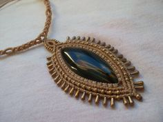 Hawk eye crimped in macramé necklace made with waxed thread and brass