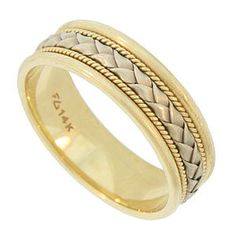 This handsome 14K bi-color vintage wedding band is a contrast of form and color. The central layer is a braid of satin finished white gold. The softly folded ribbons are framed by small twisted ropes of yellow gold. The golden braids are pressed into a wide yellow gold band. The edges of the wedding ring are softly rounded and brightly polished. A matching womens wedding ring is also available WB2474 (sold separately). The ring measures 6.28 mm in width. Circa: 1950. Size 8 3/4. We cannot…
