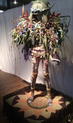 1) Interesting mannequin covered with Plants and flowers
