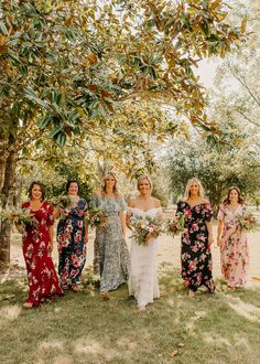 Long flower print dresses for southern boho wedding.  Stylish Muted dress choice for outdoor wedding| Georgia wedding planner Kristi Sanders of  At Last Florals | Halle Morgan Photography | Simone wedding dress | Boston wedding dresses | Georgia wedding florist | Outdoor wedding dress ideas | Boston Wedding Florist | Wedding Decor blue,  pink, yellow, tan, greenery, purple | Wedding of the year with colorful bridesmaid dresses