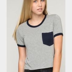 Brandy Melville t-shirt Brandy Melville black & grey pocket tee. Worn once PERFECT CONDITION. This is a size small :) Brandy Melville Tops Tees - Short Sleeve