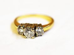 Close your eyes and count to Three, Dream of this Vintage Trinity...  Classy Vintage three stone diamond ring, set in yellow gold.