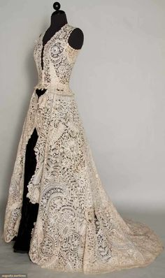 1940s wedding dress made from 1860s lace (possible from a wedding veil.)  This dress would go over a cream dress.