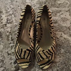 """Anne Klein Zebra Print Peep Toe Espadrilles Wedges Anne Klein black & beige peep-toe zebra print wedges. Heel measures approximately 1.5"""". Easy to walk in; great day-to-night look! Anne Klein Shoes"""