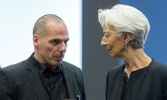 Greek Finance Minister Yanis Varoufakis (L) speaks with IMF MD Christine Lagarde