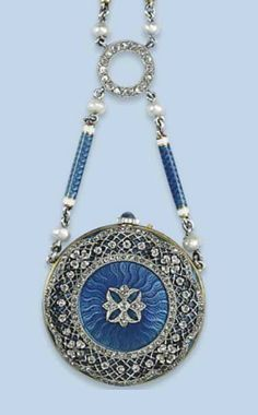 A BELLE EPOQUE ENAMEL AND DIAMOND EVENING WATCH   The watch of circular shape with blue guilloché enamelled case with diamond-set pierced border, silvered dial with Arabic numerals, sapphire cabochon crown, to an enamelled baton necklace, circa 1910.