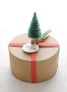 ✂ That's a Wrap ✂  diy ideas for gift packaging and wrapped presents - Adorned Glittered Tree Gift Topper by Creature Comforts, via Flickr