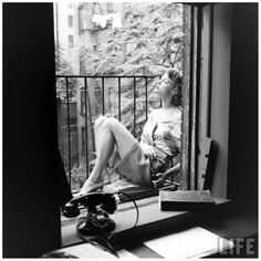 Jean Patchett escaping the heat on the fire escape of Eileen Ford's agency, photo by Nina Leen, New York City, July 1948 c