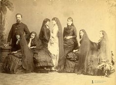 Fletcher Sutherland and his daughters, c. 1880s. In 1882 the Barnum and Bailey Circus signed a new act, called the Seven Sutherland Sisters. The girls (Sarah, Victoria, Isabella, Grace, Naomi, Mary, and Dora) ranged in age from 18 to 36. The climax of the act came when the sisters would turn in unison, letting their voluminous tresses (a collective total of 36½ feet of hair) spill down their backs.. The group made a fortune selling hair growth tonic and related products.