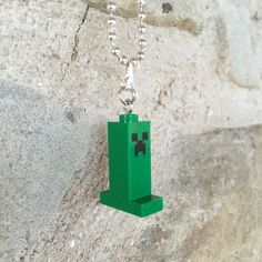 That'sss.. a nice necklace you've got there! Nice for in the Christmas sock! The creeper hangs on a 46cm silver plated ball chain and is lead/nickel free. More LEGO mini figure necklaces available at gagabricks.etsy.com