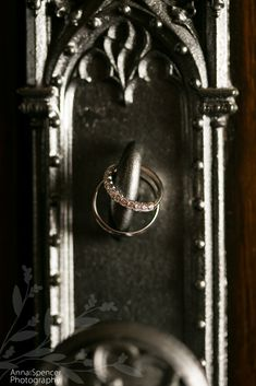 Anna and Spencer Photography, Atlanta Wedding Photographer.  Wedding Rings on the doorknob of Peachtree Christian Church in Atlanta.