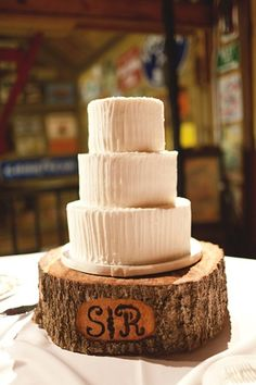 simple white cake on a rustic tree trunk cake stand | Andi Mans