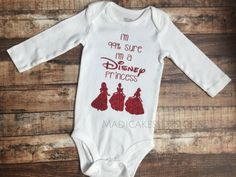 Red glitter Im 99% sure Im a Disney princess onesie or shirt. Choose sleeve length and size. Sizes newborn-24M will be brand Just One you by Carters onesies. SIZES 2T-5T ARE SHIRTS. See size chart for sizes 2T-5T: Short sleeve size chart: Bust/Chest: 2T 11-1/2 3T 12-1/2 4T 13 5T 13-3/4 FrontLengthHPS: 2T 15-3/4 3T 17 4T 18-1/4 5T 19-1/2 Weight: 2T 31-33lbs 3T 33-36lbs 4T 36-40lbs 5T 40-44lbs Height: 2T 33-36 3T 36-39 4T 39-42 5T 42-45 Long sleeve size char...