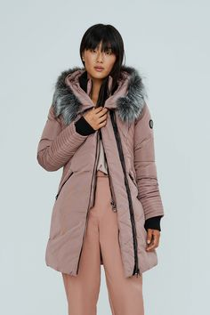 The Sam coat has a defined waist and contrasting channel quilted sleeves in vegan leather. It features a high neck, a full zip closure and internal ribbed cuffs to really lock in the warmth. The sweetheart hood is trimmed with plush vegan fur. Fit And Fix, Stylish Coat, Stylish Jackets, Beige Outfit, Womens Parka, Taupe Color, Mode Style, Fur Trim, Winter Coat