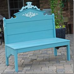Bench made from antique 3/4 bed, painted blue.