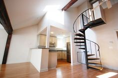 Modern Small Spiral Staircase With Metal Material In Kitchen Design With Hardwood Flooring Ideas