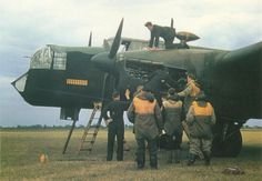 RAF mechanics are checking one of the engines of an #Armstrong Whitworth AW38 «Whitley» Mk.V medium #bomber as her crew looks on. The Whitley was one of the lesser known bomber of WW2. Note the yellow bombs painted on her side indicating the number of successful bombing missions. Probably 1943, undisclosed location in England.