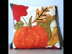 This quilted pillow for the Autumn season shows a pumpkin, gourd, and flowers. The back of the pillow is an overall brown design. Halloween Quilts, Halloween Crafts, Halloween Pillows, Wool Quilts, Applique Quilts, Fall Pillows, Throw Pillows, Pumpkin Pillows, Quilting Projects