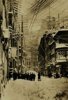 NEW YORK CITY - The Blizzard of 1888.(A group of stockbrokers surveyed the damage done near their Wall Street offices by the... ) Historical Ph +Sepia filter