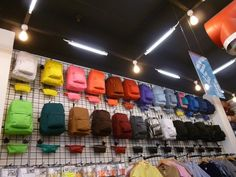 a bit too shop like. Impressive School Bag Display for Back to School love the idea of a rainbow color collection of bags.different silhouettes Showroom Design, Shop Interior Design, Retail Design, Store Design, American Apparel, Back To School Displays, Stained Glass Window Film, Bag Display, Store Displays