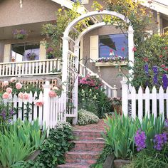 Create a sense of enclosure near the front entry by incorporating an arbor, trellis, or pergola. Just one of these structures can define the main entrance of your home while supplying structure and beauty.