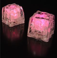 "LED Ice Cubes Pink | Pack of 8 - Bring a glamorous atmosphere to your cocktail mixer or birthday party with these glowing pieces. The Pink LED Ice Cubes are FDA approved safe for beverages, and will float at the top of your glass without watering down your drink. For an enchanting display, place these cubes in a large bowl of punch, creating a resplendent presentation for your friends. These lights come in packs of 8, and each measure 1.5"" square. These pieces have 3 modes: Steady-on…"