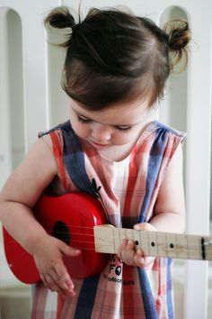 ohhh, a little red guitar for her.