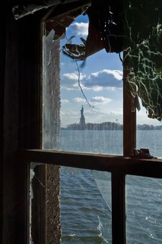 Statue of Liberty as seen from measles ward  Quarantine Hospital, Ellis Island, NY   A bit eerie to think about!