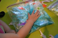 Ocean In A Bag - foam ocean stickers to stick inside & outside the bag, mini seashells, dry sand, several pumps of white hand lotion & a few drops of blue food colouring