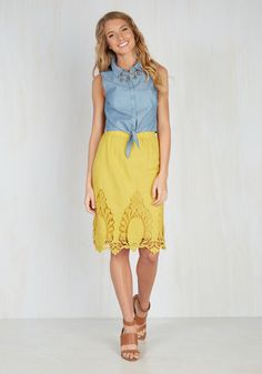 Your spontaneous lifestyle makes your agenda a mystery, but when your day includes this A-line skirt, fun times are a guarantee! Zesty with a curry yellow hue and motivating an on-the-go energy with stunning crocheted-lace appliques, this high-waisted midi - arriving in June - always plans on having you look your best!