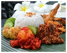 Nasi lemak Medan - fragrant coconut and pandan rice with assorted side dishes.