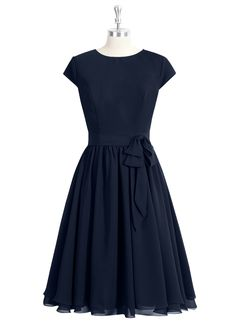 The Azazie Ingrid is the epitome of vintage elegance. It featured a high, round neckline, short sleeve design, a structured bodice, belted tie detail at the waist, and an intricately pleated A-line skirt. Available in 30+ colors, seen here in Dark Navy.