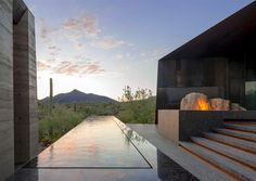"""Designed by Wendell Burnette Architects, the Desert Courtyard House is an outstanding private residence in the Sonoran Desert, Arizona. """"It seems very contradictory but this luxurious home blends perfectly with its harsh environment. The structure was built using soil excavated from the site. The concrete and rammed earth walls fit perfectly to the desiccated, earthy surroundings. The roof was clad with weathered steel. When seen from above, the roof appears like a deep shadow in the…"""