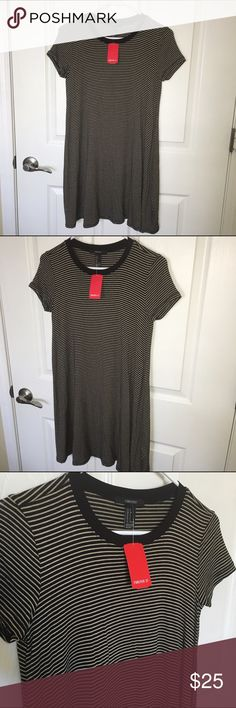 NWT Striped swing t-shirt dress. Forever 21. Striped t-shirt/swing dress. Beige & black. Short sleeve. Flowy/swing fit. Scoop neck. Stretch. 95% rayon 5% spandex. Small. NWT! Forever 21 Dresses Mini