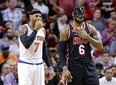 Carmelo Anthony and LeBron James share a moment in the second half of play. (February 27, 2014 | New York Knicks at Miami Heat | American Airlines Arena in Miami, Florida)