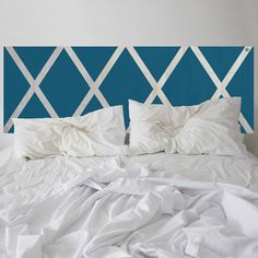 The stylish NOD Criss-Cross Headboard hand-painted in Deep Turquoise.