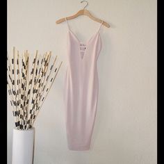 ✨ BEAUTIFUL Nude body-con Dress ✨ Brand new with tags! Beautiful body conscious nude dress. Perfect for any occasion! Excellent condition! Adjustable straps, built in slip (not see thru at all). 95% polyester, 5% spandex. This item is available in small, medium, and large.                                                                  THIS IS OUR LARGE OPTION WHICH IS EQUIVALENT TO A SIZE 6-8.                              BRAND NEW with tags from our online boutique 'The Style'…